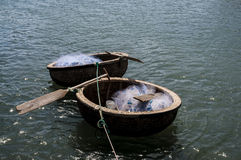 Coracles with fishing nets floating on the water Stock Photos