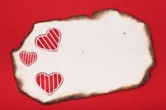 Corações e papel queimado Fotos de Stock