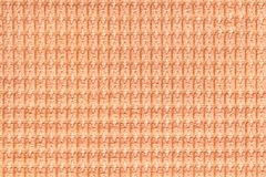 Coral background from soft fleecy fabric close up. Texture of textiles macro. Stock Photo