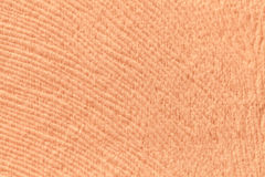 Coral background from soft textile material. Fabric with natural texture. Royalty Free Stock Images