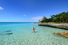 Coral beaches in Cuba. Tourist swimming in turquoise waters of the Caribbean sea on the wild noon coast of Cuba Stock Photos