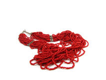 Coral beads. Red coral beads with silver details Stock Images