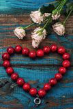 Coral beads and rose Stock Image