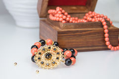 Coral and black beaded bracelet Royalty Free Stock Photos