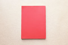Blank coral red book cover with paper texture background Stock Images
