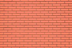 Coral brick wall background. Living Coral textural brick wall, color. Swatch stock image