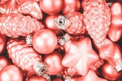 Coral Christmas baubles background. stock images