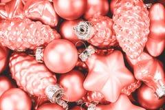 Coral Christmas-snuisterijenachtergrond stock afbeeldingen