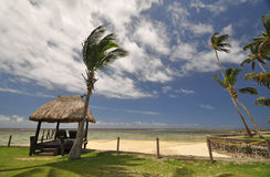 Coral Coast beach hut. The tranquil beaches of the  South Pacific Ocean really are paradise found. This thatched beach hut overlooks the Coral Coast on the Royalty Free Stock Image