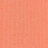 Coral color textile background from stitched silk Royalty Free Stock Image