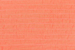 Coral color textile texture of stitched silk Royalty Free Stock Image
