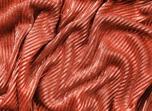 Coral colored fabric texture. Concept of color of 2019 stock images