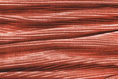 Coral colored fabric texture. Concept of color of 2019.  stock images