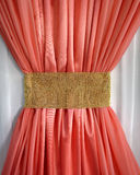 Coral curtain ruffled gold belt Royalty Free Stock Image