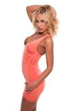 Coral dress. Pretty young blonde woman in a coral pink dress stock images