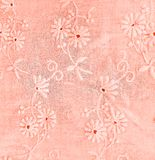 Coral floral eyelet pattern. Close up of coral colored embroidered eyelet pattern on fabric royalty free stock images
