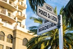Coral Gables Cityscape. Cityscape view of the street signs at the intersection of Ponce De Leon and Madeira Avenue in Coral Gables, Florida Stock Photos