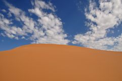 Coral pink sand dune and blue sky with white clouds. Coral Pink Sand Dunes State Park, Kanab, USA Stock Photography