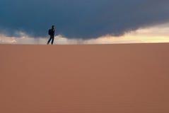 Coral Pink Sand Dunes State Park,Utah,USA. Woman hiking Coral Pink Sand Dunes, Utah royalty free stock image