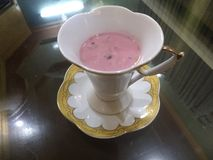 A cup of pink tea stock images