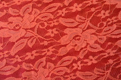 Coral red guipure lace fabric from above Stock Photo