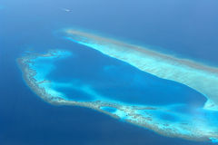 Coral reef. Aerial view of a coral reef in the Maldives stock photos