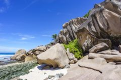 Coral reef and big granite rocks with palms at the beach of gran Stock Photo