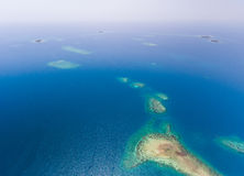 Coral Reef et antenne de Caye Photos stock
