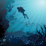 Coral reef with fish and silhouette of diver. On blue sea background Stock Image