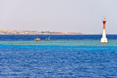 Coral reef near Tiran, Egypt. Coral reef near Tiran and its lighthouse Royalty Free Stock Photos