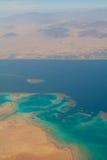 Coral reef. Red sea. Desert. Sinai. Egypt. Aerial view coral reefs, Red sea and Sinai desert with mountains. Sharm El Sheikh. Nabq bay Royalty Free Stock Photography