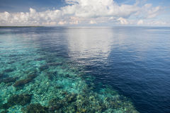 Calm Seas, Blue Sky, and Coral Reef Dropoff Stock Photography