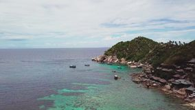 Coral Reef in Turquoise Lagoon Water beside Rocky Shoreline with Big Stones in Tropical Country. Aerial Top View. Shot with a DJI Mavic fps 29,97 4k stock video footage