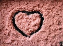 Coral sand with a heart-shaped pattern. royalty free stock photos