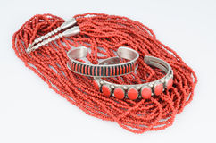 Coral and Silver Bracelets with Bead Necklace. Royalty Free Stock Photos