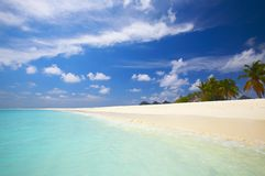 Coral tropical beach. On the island Kuredu in the Indian Ocean, Maldives Royalty Free Stock Photo