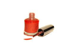 Coral varnish bottle with a brush Royalty Free Stock Photos