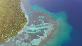 Aerial of Reef and Tropical Island in Papua New Guinea. Corals grow in the shallows along the coast of New Britain in Papua New Guinea. This remote, tropical stock video