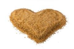 Coração do açúcar granulado de lingüeta não refinado Imagens de Stock Royalty Free