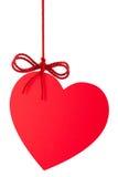 Coração-Valentim com uma curva que pendura em uma corda Imagem de Stock Royalty Free