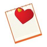 Coração vermelho em um caderno Imagem de Stock Royalty Free