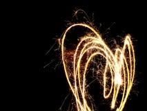 Corazón ardiente hecho con las bengalas Foto de archivo libre de regalías