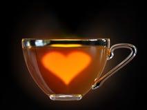 Corazón caliente en la taza de té Fotos de archivo