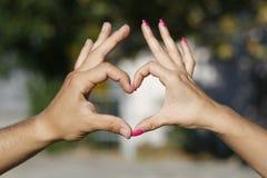 Corazón con alas por las manos foto de archivo libre de regalías