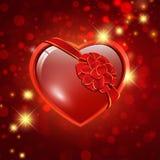 Corazón con el arqueamiento de la cinta Fotos de archivo libres de regalías