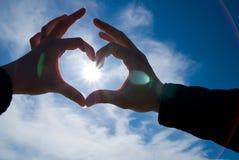 Corazón con el sol adentro Imagenes de archivo