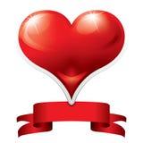 Corazón con la cinta roja Fotos de archivo libres de regalías
