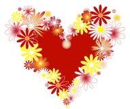 Corazón con las flores. Fotos de archivo