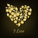 Corazón con las manzanas de oro Fotos de archivo