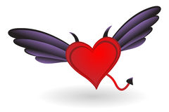 Corazón con los claxones y las alas Foto de archivo